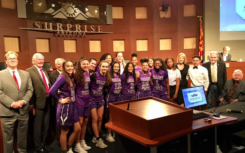 Surprise City Council member with Valley Vista High School Girls 6A State Champion Basketball Team at Surprise City Hall Council Chambers.