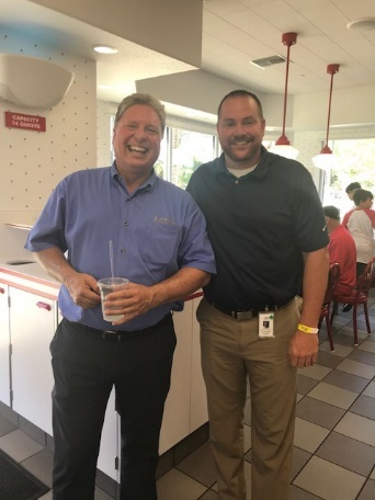 Councilmemebr Duffy celebrating the Surprise In N out Grand Opening