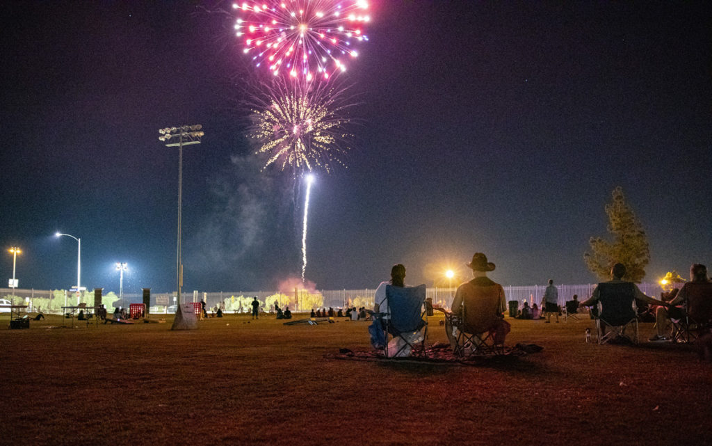 Residents watch the Surprise 4th of July celebration fireworks display from Mark Coronado Park.