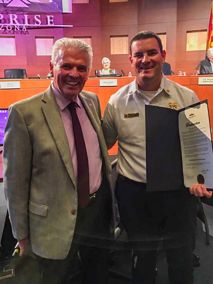Mayor Hall presents the proclamation for Drowning Prevention Awareness Season.