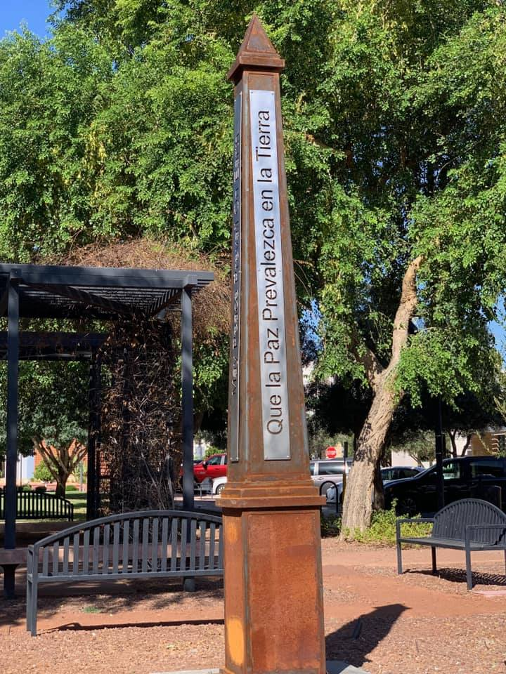 The Peace Pole, a monument displayed outside City Hall.