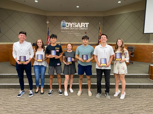 Dysart District students present their Athlete of the Month plaques.