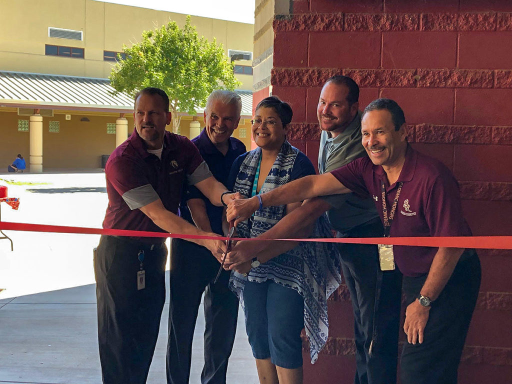 Mayor Hall, Councilmember Duffy and Shadow Ridge faculty cut the ribbon for the student run school store, the Stable.