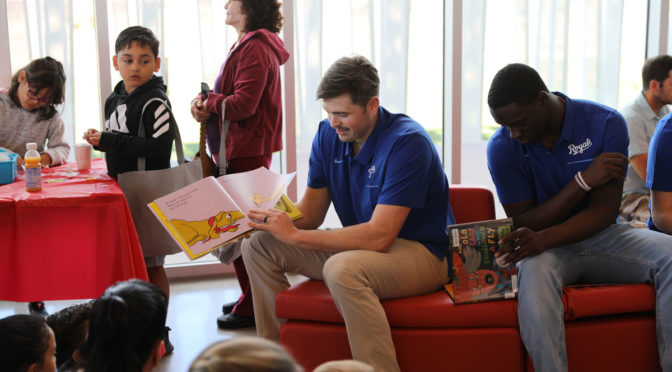 Kansas City Royals players read to children at Asante Library.