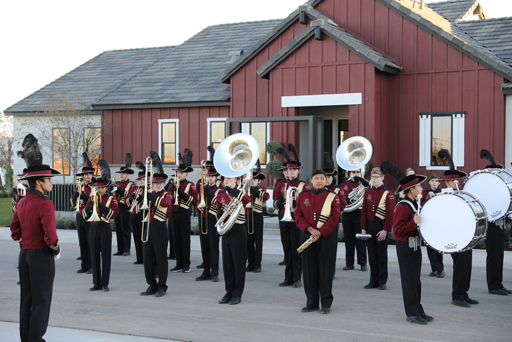 A marching band plays at the Toll Brother's Community grand opening event.