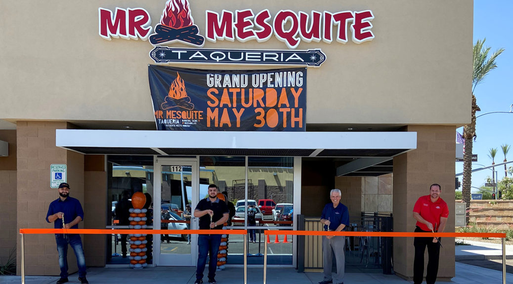 Mayor Hall, Councilmember Duffy and the owners of Mr. Mesquite Taqueria cut an orange ribbon for the business' grand opening.