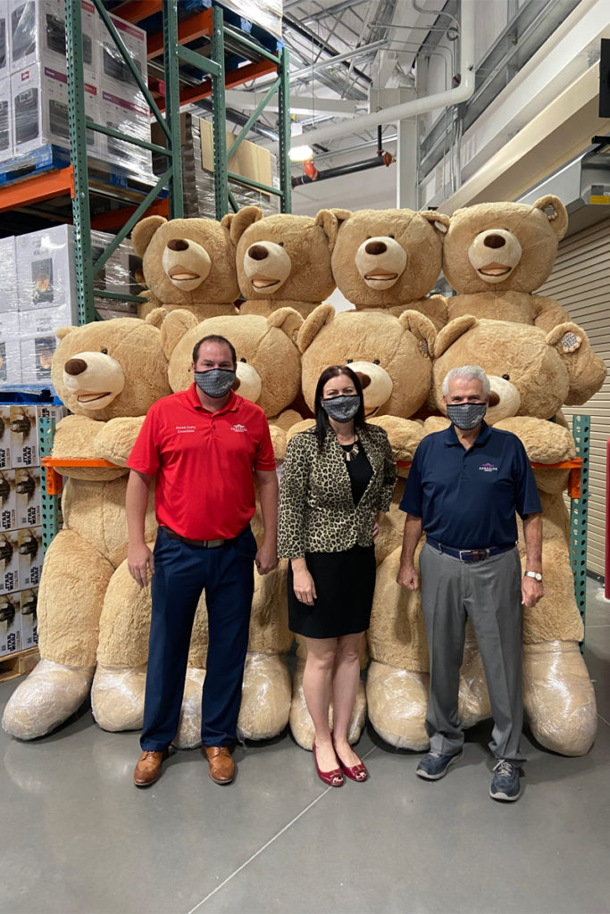 Councilmember Duffy, Jeanine Jerkovic and Mayor Hall stand in front of a display of oversized teddy bears.