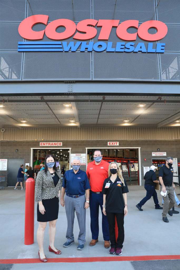 Jeanine Jerkovic, Mayor Hall and Councilmember Duffy stand at the entrance of the newly opened Costco.