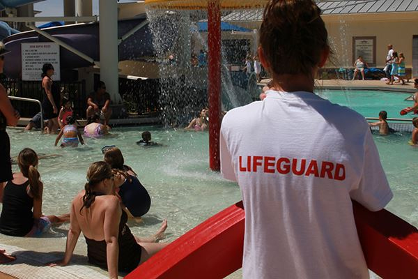 A lifeguard stands watch over individuals at the Surprise pool.